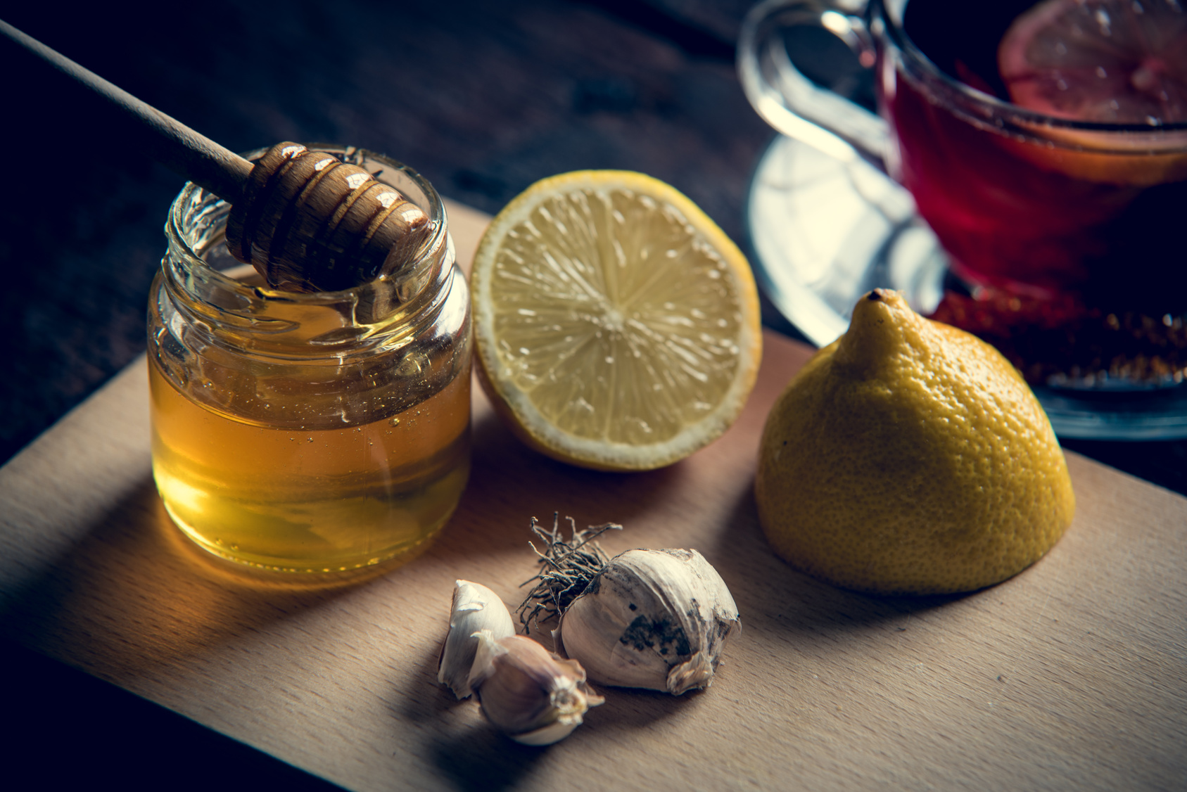 Natural medicines against flue and cold. Honey, lemon and garlic. Health and alternative medicine concept.